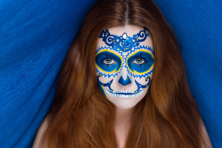 New creative calavera is a representation of human skull. applied to decorative make up the Mexican celebration of the Day of the Dead Dia de los Muertos and the Roman Catholic holiday All Souls Day.