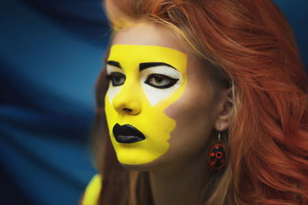 Woman with creative makeup of yellow sunset hallucinations, surrealism. Crazy art concept new idea Stock Photo