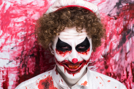 Creative make-up, conceptual crazy idea for Halloween night party. Eerie nightmare turning into zombie clown, volume spikes body art painting. Professional closeup photo. Bold skin injured, curly hair Stock Photo - 88298009