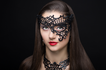 Beauty portrait beautiful woman girl lady model red lips and long straight brunette hair. Professional makeup studio. New big sexy carnival mask prepare for party masquerade Brazil Italy Venice France Stock Photo