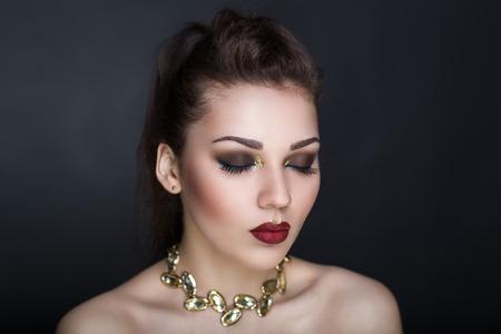 Closeup portrait of beautiful girl woman lady hair styling. Luxury professional makeup. Bright dark red marsala shiny lipstick. Sexy body necked shoulders. New Horizontal photo gray dark background