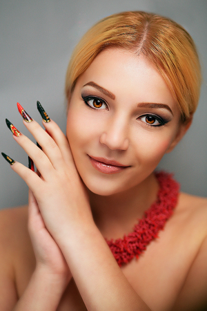 Beautiful blonde woman plays a role, long lashes. White skin magic beautiful lady, professional model makeup, very long nails extension, full fashion look. New make-up made by professional cosmetics