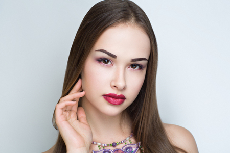 Closeup portrait of beautiful girl woman lady hair styling. Luxury professional makeup. Bright dark red crimson shiny lipstick. Sexy body necked shoulders. New Horizontal photo gray white background  Stock Photo