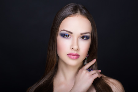 Closeup portrait beautiful girl woman lady with combed hair styling. Luxury bright blue shadows makeup, shiny pink lipstick lip gloss. Professional photo model vip person. hand fingers nails manicure