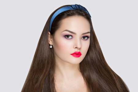 Closeup portrait of beautiful girl woman lady with volume combed hair styling. Luxury black combed hair. Bright pink makeup, shiny lip-gloss lipstick cosmetics. Professional photo model vip person