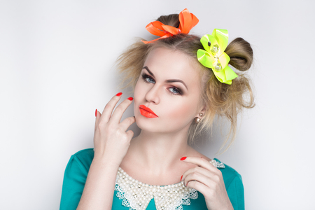 Closeup portrait of beautiful girl woman lady, professional manicure make up, hair styling. Luxury accessory New Bright orange color, shiny lipstick glossy cosmetics. Young pretty photo model person