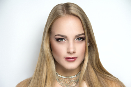Closeup portrait of beautiful girl woman lady with volume combed hair styling. Luxury blonde gray white silver combed hair. Bright brown makeup, new shiny lipstick. Professional photo model vip person