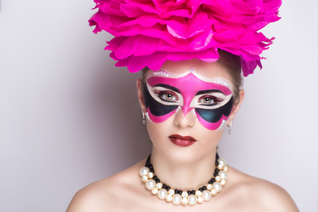 retro christmas: Beauty portrait of beautiful young woman girl lady model, red lips and big pink accessory. Professional makeup studio. New big carnival mask prepare for party masquerade in Brazil Italy Venice France Stock Photo