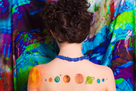 Drawing parade of planets solar system on beige skin woman lady back shoulders. Bright color picture abstract, painting design for astrology party. Close up professional horizontal photo new banner