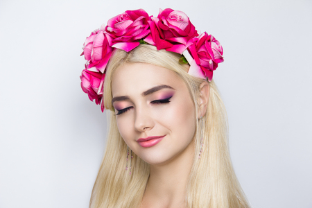 Closeup portrait of beautiful girl woman lady with volume combed hair styling. Luxury blonde gray white silver combed hair. Bright pink makeup, new shiny lipstick. Professional photo model vip person