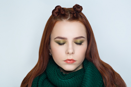Creative woman lady girl model new play green brown colors. Bright conceptual art make-up glows light party time. Multicolored idea, crazy hair design bun, ponytails collected. Positive good lifestyle