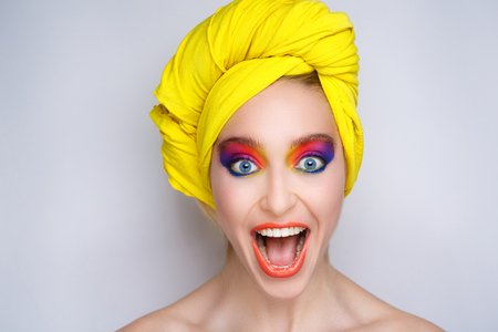 Creative make-up new conceptual idea. pink blue orange red yellow white bold art painting. Crazy graphic abstract picture woman face surrealistic. professional photo. Creativity pop art, lines shadows Stock Photo