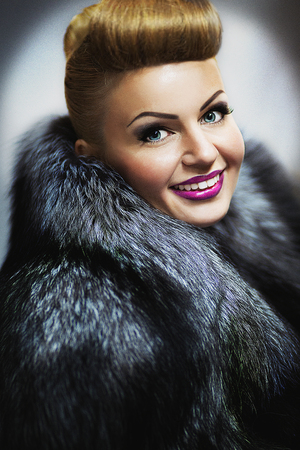 New Close up portrait of beautiful woman pretty lady sexy girl young face vip makeup. Long fur coat vest gray black coloring, surround collar warm in winter from cold. Clothing store, custom tailoring Stockfoto