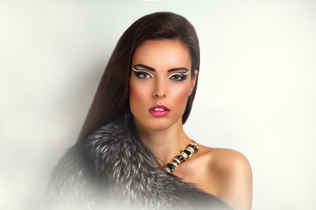 New Close up portrait of beautiful woman pretty lady sexy girl young face vip makeup. Long fur coat vest gray black coloring, surround collar warm in winter from cold. Clothing store, custom tailoring Stock Photo