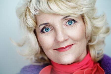 Closeup portrait beautiful age lifting woman lady make up studio styling blonde. Luxury makeup Bright eyes, shiny beige lips lipstick. Professional photo exclusive model vip person, gray background