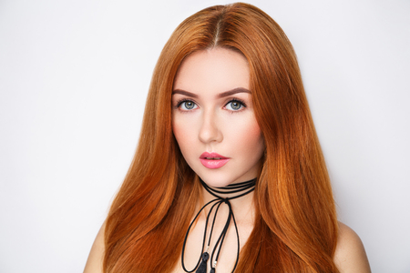 Young beautiful girl woman lady female with fashionable choker lace around her neck, professional makeup. Long orange straight hair, arrows beige eye shadows, natural lipstick gloss. Luxury accessory