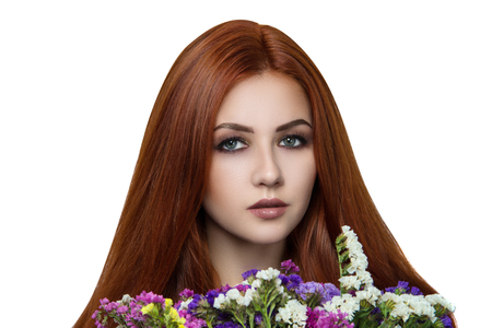 Bright orange brown long straight hair. Oriental beauty girl professional makeup. Portrait beautiful woman lady nymph holding flowers smell bouquet. Young gypsy fortune teller predicts fate horoscope Stock Photo