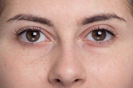 Eyebrow Before Correction. Close-up macro photo, big opened eye, care, review of eyes, light brown coloring natural shape procedure nude make-up. Care, thin out, pull out. woman needs new cosmetology Archivio Fotografico