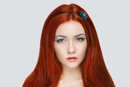 Bright orange brown long straight hair. Oriental beauty girl green professional makeup. Portrait of a beautiful woman who wore head tiara accessory. Young gypsy fortune teller predicts fate horoscope 스톡 콘텐츠