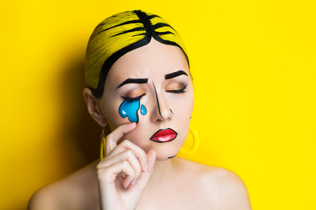 New Creative woman lady girl model play comics blue red yellow colors. Bright conceptual art makeup glows light party time. Multicolored paints coloring hair. Positive good lifestyle vintage, earrings