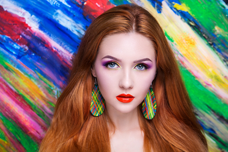 Creative make-up new conceptual idea. colorful bold faceart body art painting. Crazy new graphic abstract picture, woman face surrealistic. professional photo. Creativity art lines concept perfection Stock Photo