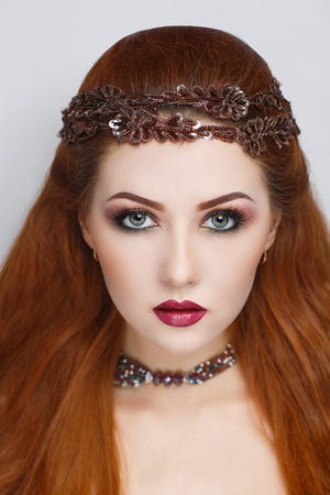 Bright straight hair. Oriental beauty girl professional makeup. Big head tiara accessory. Young gypsy fortune teller predicts fate horoscope. studio horizontal banner, ethnic woman close up portrait