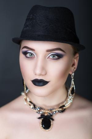 Closeup portrait of beautiful girl woman lady with make up studio styling. Luxury makeup Bright black white purple, shiny lipstick. Professional photo exclusive model vip person, dark background