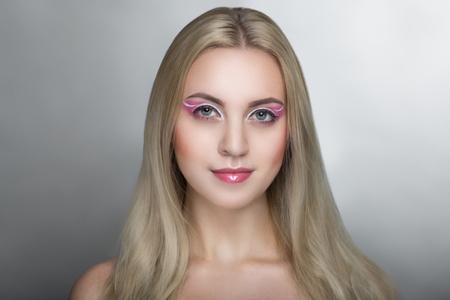 Closeup portrait of beautiful girl woman lady with volume combed hair styling. Luxury blonde gray white silver combed hair. Bright pink makeup, shiny lipstick. Professional photo model vip person