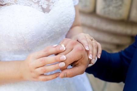 Two hands holding, man covers woman hand. Beautiful young couple, wedding romantic date. Sincere devotion feelings of love charm tenderness. social problem family, fidelity in marriage, conjugal duty Reklamní fotografie