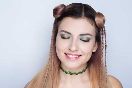 Creative woman lady girl model play yellow green colors. Bright conceptual art make-up glows light party time. Multicolored idea, crazy hair design bun, ponytails collected. Positive good lifestyle