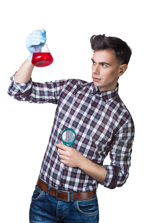 Young Handsome guy in a plaid shirt. invention modern ideas, creative mad scientist generates a fantasies into new projects. man assistant student studying original props for Physics Chemistry Science
