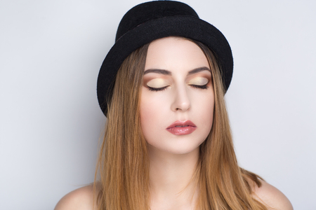 Closeup portrait of beautiful pretty girl woman lady with make up studio styling. Luxury makeup Bright brown shiny lipstick lipgloss. New Professional photo exclusive model vip person light background Stock Photo