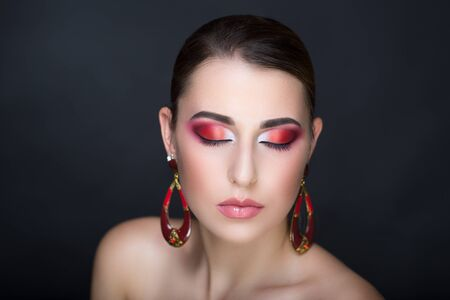 Close up portrait woman make up. Big red long round circle earrings, accessory decorates ears, artificial transparent stones. Horizontal banner, new conceptual idea. Professional photo model necked