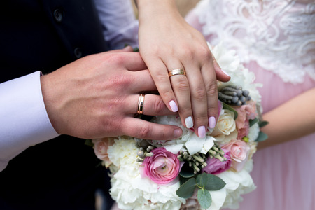 Two hands holding, man covers woman hand. Beautiful young couple, wedding romantic date. Sincere devotion feelings of love charm tenderness. social problem family, fidelity in marriage, conjugal duty Stock Photo