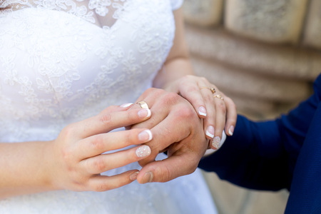 Two hands holding, man covers woman hand. Beautiful young couple, wedding romantic date. Sincere devotion feelings of love charm tenderness. social problem family, fidelity in marriage, conjugal duty Imagens