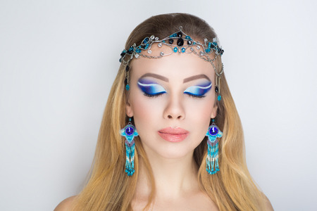 Closeup portrait beautiful girl woman lady with volume combed hair styling. Luxury long golden hair. Bright makeup tender lip-gloss new lipstick. Professional photo model person horizontal arabic toys