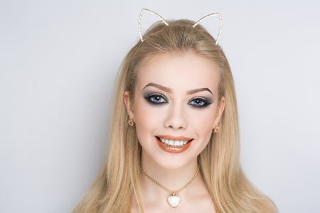 Young beautiful bright showy girl lady model kitten queen. Fairy tale future party cosplay club. new makeup flawless face big eyes perfect eyebrows beige lips. Facial spa, volume blonde hair, sexy cat
