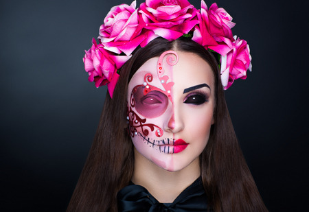 New creative calavera is a representation of human skull. applied to decorative make up the Mexican celebration of the Day of the Dead Dia de los Muertos and the Roman Catholic holiday All Souls Day
