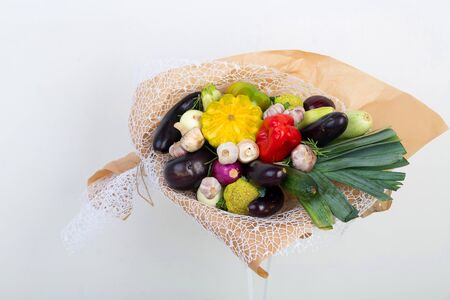 Bouquet made of vegetables. original unusual edible present. Close up. useful gift for a proper lifestyle. autumn bouquet of fresh squash, pumpkin, mushrooms, concept of accumulate vitamins for winter