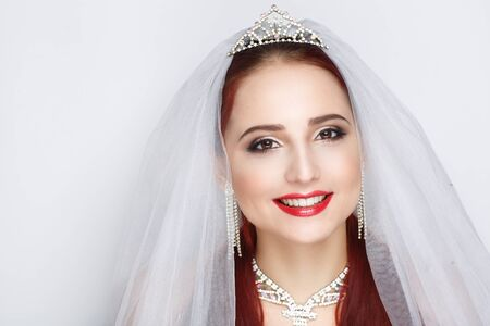 Beautiful bride woman girl lady princess prepare for wedding - white long veil, silver swarovski diamond crown, necklace. Professional make up bright eyes, red lip-gloss lipstick. background clipping