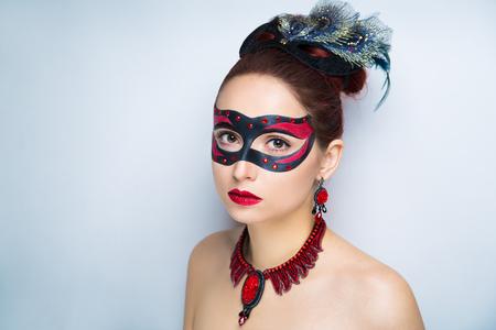 Beautiful woman wearing massive jewellery. Black mask, hair-do. Professional cosmetics makeup. Shiny red lips lipstick lip-gloss. New photo close up portrait, gray color background horizontal banner