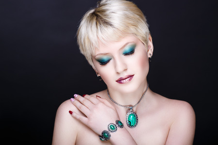 Closeup portrait - beautiful woman face. Blonde short haircut styling. Luxury professional art makeup. Sexy body necked shoulders. New photo close up background horizontal
