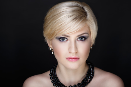 Closeup portrait - beautiful woman face. Blonde short haircut styling. Luxury professional art makeup. Sexy body necked shoulders. New photo close up Stock Photo
