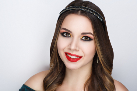 Closeup portrait of beautiful girl woman lady with volume combed hair styling. Luxury wavy combed hair tiara. Bright shadows makeup, shiny red lipstick lip gloss. Professional photo model vip person Stock Photo