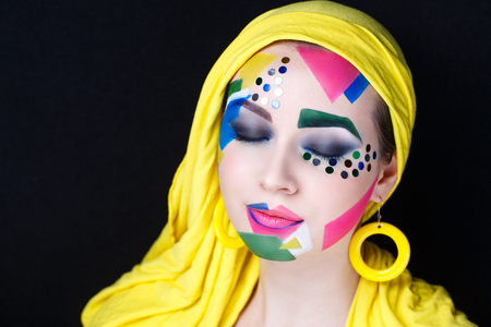 Creative make-up new conceptual idea. pink yellow white bold body art painting. Crazy graphic abstract picture woman face surrealistic. professional photo. Creativity pop art lines triangles circles