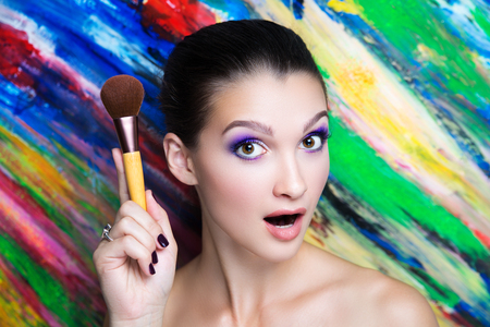 Creative make-up new conceptual idea. colorful bold faceart body art painting. Crazy new graphic abstract picture, woman face surrealistic. professional photo. Creativity art lines concept perfection Banque d'images