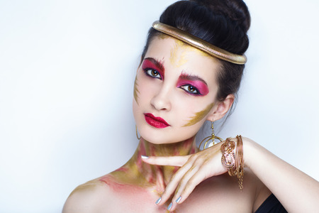 Creative makeup, new crazy conceptual idea for Halloween. golden pink bold body art painting. graphic abstract picture on woman face, body-art. shiny lipstick lip-gloss lips. professional photo banner
