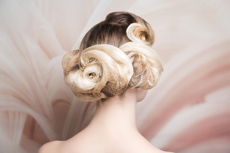 Woman blonde medium length hair. Wedding hairstyle gathered hair-do curls. Beautiful bride Russian style. Close-up portrait beauty girl woman lady, volume hair-do. Luxury styling salon. new conceptual