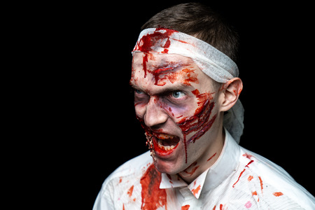 Crazy zombie horror make up. Person in white shirt with bloody sweat. Scars, deep scratches realistic art make-up. head is re-banded bandage, beaten with a stick. Horizontal banner for Halloween party Reklamní fotografie - 109902433
