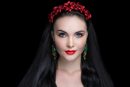 Sexy girl with gorgeous black hair, professional dark makeup. Thick hair hairstyle extensions, dyeing, hair-do care products shampoo. Handmade beads Jewellery, hand-made jewels. New Horizontal banner